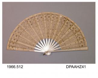 Fan, white tissue paper leaf decorated with silver and gold sequins and pailettes, plain pale grey wooden sticks and guards printed silver lily of the valley and other flowers, gilt loop, approximate radius 212mm, late nineteenth century or early twenti