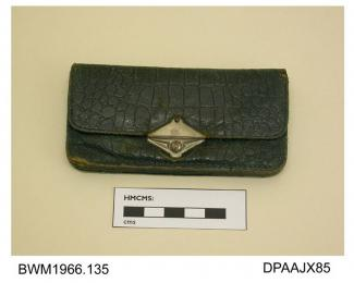 Purse, dark green leather, possibly crocodile, envelope style with slide catch closure, divided into six separate sections, central section with metal edge stiffening, approximate length 110mm, approximate width 55mm, c1920-1950