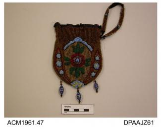 Purse, small, dark purple silk closely beaded all over in tiny beads, stylized floral design in sombre shades brown, dark red, green black and pale blue, base trimmed three beaded tassels each with a large yellow and blue glass bead, possibly Murano wor