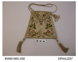 Bag, reticule, white moire silk on stiffened base, front embroidered with sprays of foliage and flowers, some ribbon work detail, flap closure, original button missing, replaced with imitation pearl clasp from necklace, flap edged cream silk fringe, cre