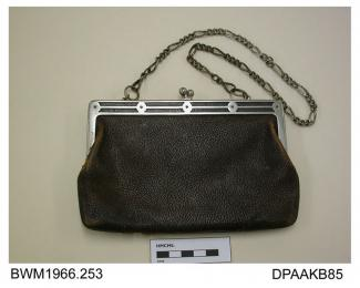Handbag, brown morocco leather, metal frame with snap closure and decorative chain handle, lined tan suede, approximate width frame 170mm, approximate depth 115mm, c1900-1920