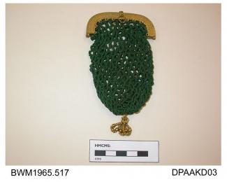 Purse, small, green silk mesh in button hole stitch, unlined, embossed pinchbeck frame with press closure, and ring fitting, base trimmed with ornate pinchbeck bead tassel, approximate width 65mm, approximate depth 100mm, c1800-1840