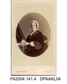 Photograph, oval, The Honourable Dowager Lady Arundell seated at a writing table, taken by Jabez Hughes of Ryde, Isle of Wightvol 1, page 3