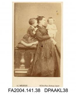 Photograph, Lady Rawlinson with two small children, standing leaning against a balustrade, taken by A J Melhuish of Londonvol 1, page 6 - Relatives and Friends