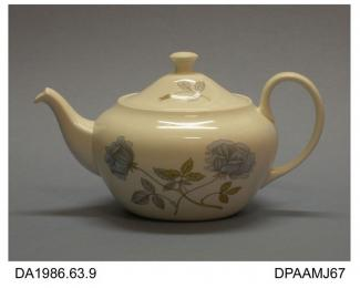 Teapot, bone china, oval Coupe Savoy shape, colour litho-printed overglaze in Ice Rose pattern designed by Wedgwood's Chief Designer, Robert Minkin, printed factory mark on base, made by Josiah Wedgwood and Sons, Barlaston, Staffordshire, 1967