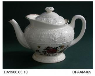 Teapot, creamware, Wellesley shape decorated with Bullfinch pattern; printed mark on base incorporating shape and pattern names and USA patent numbers, made by Josiah Wedgwood and Sons, Etruria or Barlaston, Staffordshire, c1932-1950 Wellesley shape was