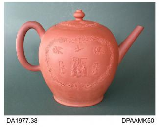 Punch pot, or teapot, red stoneware, inverted pear shape, applied sprigs of exotic birds and chinoiserie figures - one possibly showing the making and consumption of hot punch - within a rococo border, pseudo-Chinese seal mark on base, made in Staffords