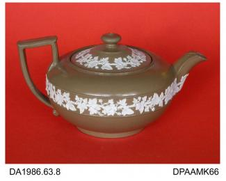 Teapot, drab stoneware, low round shape (Wedgwood's no 43 or Egyptian shape), smear-glazed, applied sprigged white ivy leaf borders, impressed WEDGWOOD and V on base, made by Wedgwood, Etruria, Stoke-on-Trent, Staffordshire, c1830