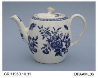 Teapot, soaprock porcelain, barrel shape with flower knop on lid, indented handle and countersunk base, decorated in underglaze blue printed Three Flowers pattern, blue painted hatched crescent mark on base, made in Worcester, Hereford and Worcester, c1