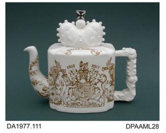 Teapot, white earthenware, rectangular shape with coved corners and lid in the form of a crown surmounted by a silver lustred cross, printed decoration consisting of the Royal arms and national emblems, printed factory and silver lustre painted piece ma