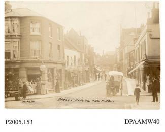 Photograph, sepia, showing exterior views of Wadmore grocers, Winchester Street looking towards Market Place before the great fire, Basingstoke, Hampshire. 1905