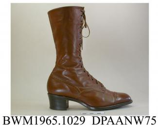 Boots, pair, women's, tan calf, front laced with sixteen pairs of eyelets and narrow brown laces over full length tongue, rounded toe with toecap, curved side seams, straight rear seam with tapered strip of matching leather covering lower half, stacked