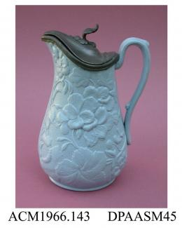 Jug, blue-stained stoneware, hinged pewter lid, decorated with a relief-moulded design of pelargoniums (geraniums) on a stippled ground; base, moulded registered design mark with encoded date of 4th January 1855, made by Worthington and Green, Brook Str