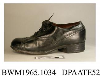Shoes, pair, child's, black leather, rounded toe with toecap and punched detail at seams, straight rear seam covered shaped strip of leather, front laced with four pairs of eyelets and wide black laces over full length tongue, lined black kid and white