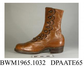 Boots, pair, child's, ankle boots, brown leather, side buttoned with eight domed brown boot buttons and a scallop edged closure, galosh with toecap and finely punched detail to seam, rounded toe, straight rear seam half covered with tapered strip of lea