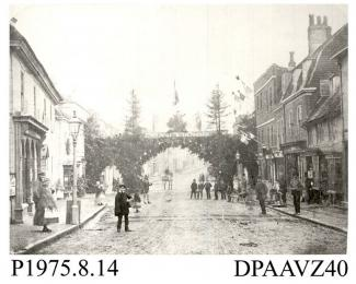 Photograph, black and white, showing the decorated archway, in celebration of the wedding of Prince of Wales and Princess Alexandra, Alton, Hampshire, 1866