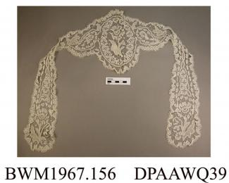 Cap, day cap, women's, braid lace with lappets, a flower motif at the end of each lappet and in centre of cap, approximate length including lappets 480mm, approximate depth of cap 190mm, c1880s