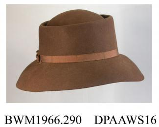 Hat, men's, brown felt, high pork pie style crown, wide brim, narrow brown petersham hatband tied in bow on right, fabric label Reslaw, London W1, unlined, large pale stain on underside of brim, approximate height 135mm, approximate length 290mm, c1950-