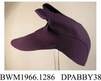 Hat, women's, dark navy wool felt, in the style of a headscarf worn with ends tied in a bow on the crown, deep peaked fron1, close fitting crown trimmed with two broad bands of felt folded and tied down over the brow, inner band of narrow black petersha
