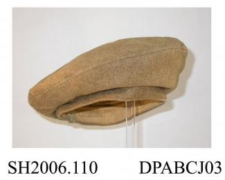 Beret, khaki twilled wool serge, British Army issue, slightly stiffened crown, narrow hatband with stiffening, lined khaki cotton, quilted, lining printed WD, size Large, approximate diameter 265mm, c1943-1955