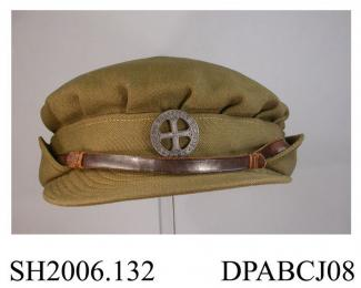 Cap, hat, women's, FANY, First Aid Nursing Yeomanry, officer's cap, FANY cap badge, leather hat band, khaki gabardine,  size medium W broad arrow D 821, part of SH2006.131, approximate diameter of crown 210mm, c1938-1945