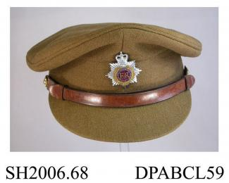 Cap, peaked cap, Service Dress officer cap, Royal Army Service Corps badge, khaki twilled wool serge, crown of Queen Elizabeth II, initials of owner, DCN, in enamelled badge form attached to inner sweat band, brown leather hat strap above peak, spare st