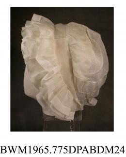 Day cap, cap, women's, white muslin, three rows of deep muslin frills with narrow bands of muslin between which frame the face, capband of muslin, full caul gathered in to capband and having two rows of drawstrings between crown and nape, single muslin