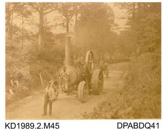 Photograph, sepia, showing a man with flag in front of a front steering self propelled traction engine, named Hero, Salisbury, Wiltshire, built by Tasker and Co, Waterloo Foundry, Anna Valley, Abbotts Ann, Hampshire, 1860