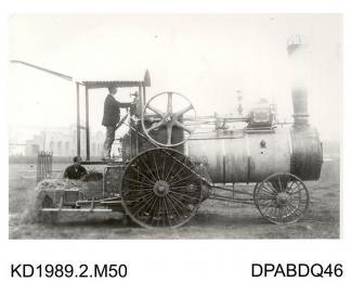Photograph, black and white, showing a straw burning traction engine with Argentine type wheels, built by Tasker and Co, Waterloo Foundry, Anna Valley, Abbotts Ann, Hampshire