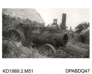 Photograph, black and white, showing a derelict traction engine for Ben Fletcher, built by Tasker and Co, Waterloo Foundry, Anna Valley, Abbotts Ann, Hampshire