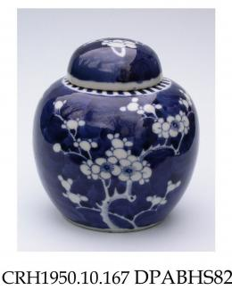Ginger jar, hard paste porcelain, blue painted scale ground with reserves of white prunus blossom and denticulated border on shoulder; double blue circle on base, made in Jingdezhen, Jiangxi Province, China, c1900-1925
