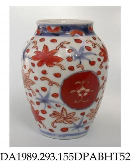 Vase, hard paste porcelain, ovoid with short neck, decorated with iron red, blue and gold dots and florettes surrounding two circular shield-like motifs; not marked, probably made in Jingdezhen, Jiangxi Province, China, c1925-1950