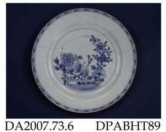 Plate, hard paste porcelain, painted blue underglaze with peony and other flowering plants in a garden, brown edge; not marked, made in Jingdezhen, Jiangxi Province, China, c1750-1775