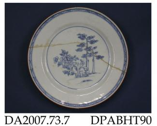 Plate, hard paste porcelain, painted blue underglaze with trees, peony and stylised rocks, brown edge; not marked, made in Jingdezhen, Jiangxi Province, China, c1750-1775