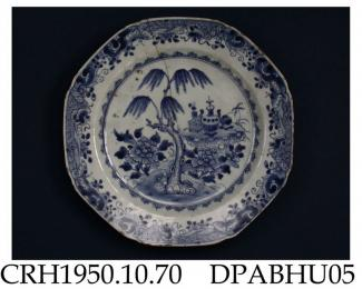 Plate, hard paste porcelain, octagonal, decorated with a blue painted willow tree, peonies and objects on a rock table within an insect and scroll border; not marked,, made in Jingdezhen, Jiangxi Province, China, c1750-1775