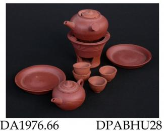 Toy tea set, red stoneware, consisting of a teapot, 4 tea bowls, 2 dishes, a side-handled kettle and a brazier; not marked, made in Yixing, Jiangsu Province, China, 1948 dated 1948 from file