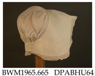 Bonnet, cap, infant's, coif style, white linen, lined headpiece extends round to nape, caul gathered into this with fullness at top, edged with muslin strips gathered at corners and centre, muslin 5mm wide increasing to 15mm for 30mm at centre of headpi