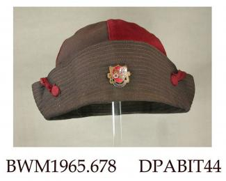 Hat, part of uniform of Girls High School, Basingstoke, round, soft crown made of four segments of woollen fabric in alternate dark red and black, medium brim with topstitching turned up and held together at each side with a band of dark red fabric secu