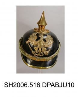 Helmet, men's, military, German Army helmet World War I, pickelbaube, black lacquered leather, peaked trimmed metal strip, brass spiked crown, brass helmet plate attached to front with spread eagle motif and FR in centre, motto reads 'mit gott fur korni