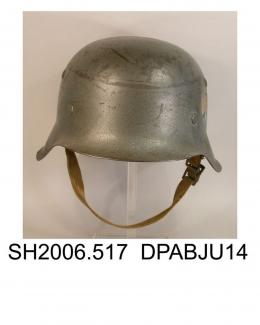 Helmet, men's, military, German Army helmet World War II, M42 moulded steel helmet of grey green colour, short front peak, longer side and rear sections, remains of printed badge on left of crown with spread eagle and swastika motif, inner adjustable sw