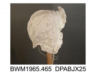 Bonnet, cap, infant's, fine white linen, caul trimmed three rows cording, two rows cording and frills around face, tied outside on brow, single frill around lower edge and divided at nape, 70mm diameter crown, approximate height 175mm, approximate depth