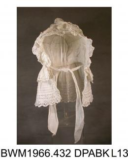 Bonnet, day cap, white cotton and broderie anglaise, front edged with frill of broderie anglaise, headpiece trimmed with two frills of broderie anglaise, nape trimmed with deep frill of broderie anglaise and four rows of fine pintucks, round crown with