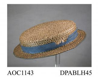 Hat, child's, black and white straw braid, boater shaped, shallow crown with a light blue ribbon hatband, now damaged, narrow brim edged matching blue ribbon, lined cotton gauze, top of crown lined with white paper printed Superior Manufacture, bought i