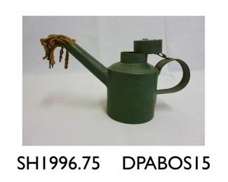 Flare lamp, railway driver's inspection flare lamp, metal pot metal pot to hold oil or paraffin, with handle,  painted green, long spout with cotton wick protruding from the end at end, filler cap attached to the handle by a chain, said to be used  used