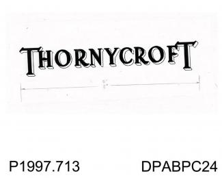 Negative, black and white, showing the Thornycroft logo