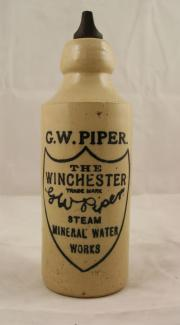 Stoneware mineral water bottle for G.W. Piper Steam Mineral Water Works of Winchester. The bottle has a screw stopper but it is not neccessarily original. the manufacturer's stamp of Price Bristol can also be made out very faintly.