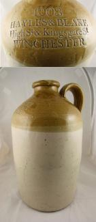 Brown and cream stoneware jug used for wine or spirits and used by Hayles & Blake High St & Kingsgate St Winchester. Also stamped with the manufacturer's mark of Powell, Bristol.