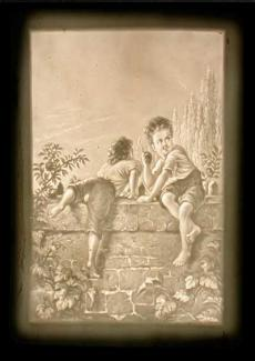 Two boys climbing over a wall scrumping apples
