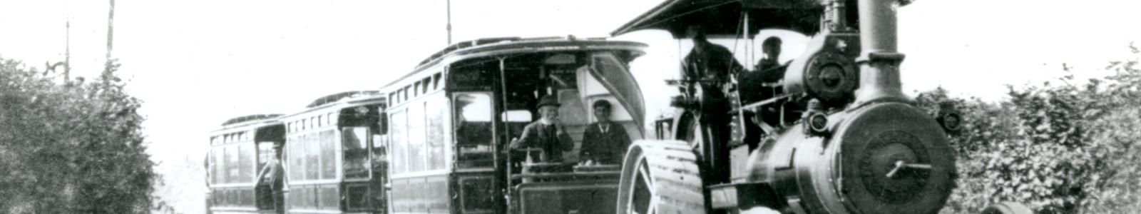 Photograph, black and white, showing Samual Hackett in the back of a steam wagon milkcart with crane, built by Tasker and Co, Waterloo Foundry, Anna Valley, Abbotts Ann, Hampshire